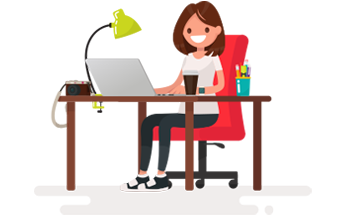 Girl Sitting At Her Computer Smiling